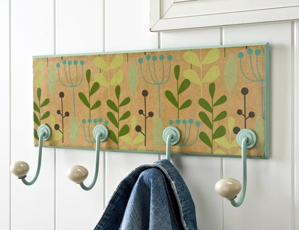 Revamp a 5 dollar coat rack with spray paint, wrapping paper and Mod Podge.