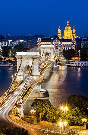 The Szechenyi Chain Bridge is a suspension bridge that spans the River Danube between Buda and Pest, the western and eastern sides of Budapest, the capital of Hungary.