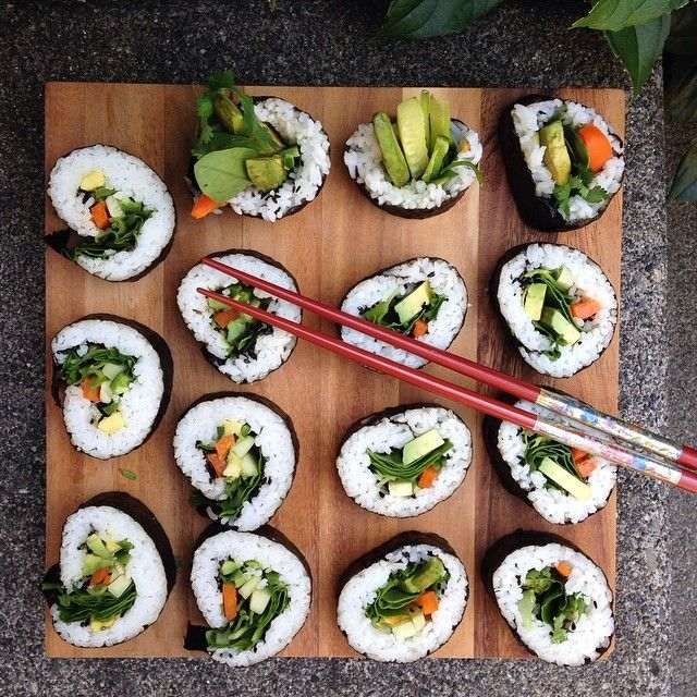 Avocado, cucumber, green onion, cilantro, bell pepper, and spinach all rolled up in nori with rice