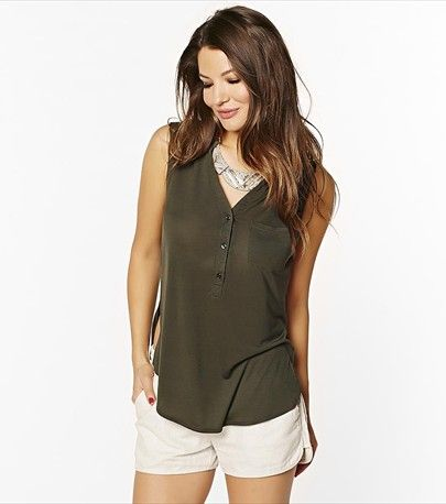 The perfect sleeveless henley top for warmer days in a trendy dark green shade.
