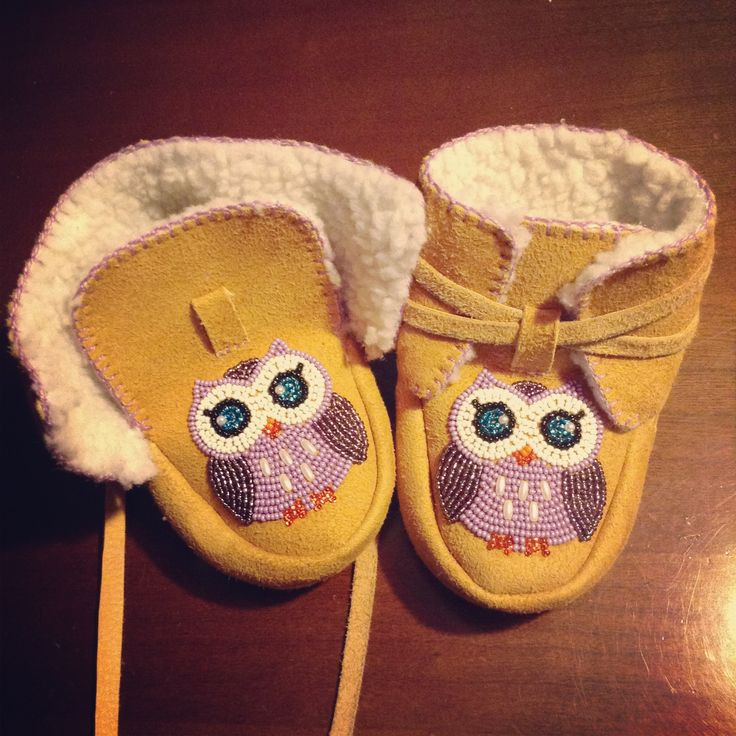I made these baby booties for my baby. They're made out of deer hide, pile lining, embroidery thread and seed beads.