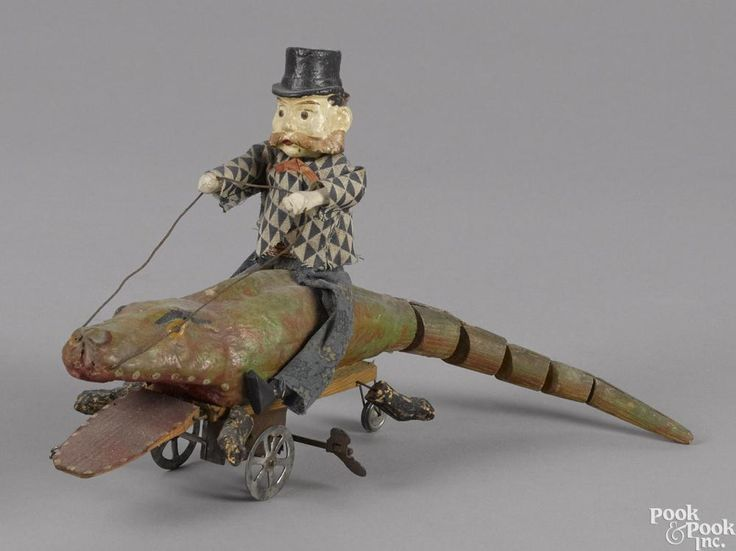 Unusual German composition and wood man riding an alligator clockwork toy - Price Estimate: $400 - $600