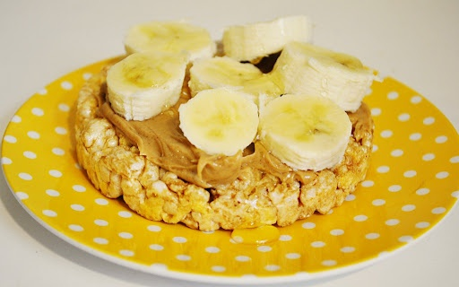 Caramel rice cakes with peanut butter and bananas. Best simple, healthy snack ever!