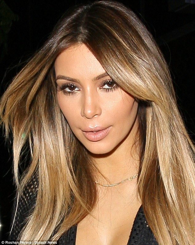 Frozen face: Kim Kardashian's features seem suspiciously smooth as she stepped out with friend Britney Gastineau in Beverly Hills on Friday night