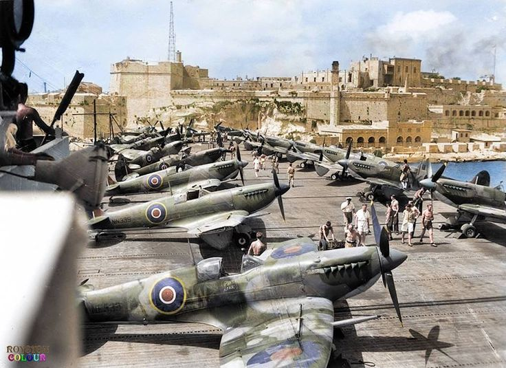 Unsinkable Malta ☼ Rare colour photo from 1944... Supermarine Seafire L.IIIs of RNAS 808 Squadron on the deck of the escort aircraft carrier HMS Khedive (02), entering the Grand Harbour of Valletta in Malta. July 1944.  (© Imperial War Museum A 25400)