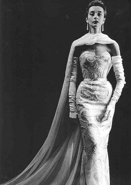 Sequined and beaded evening gown with chiffon stole, by Pierre Balmain, French, 1953. Photo by Willy Maywald.