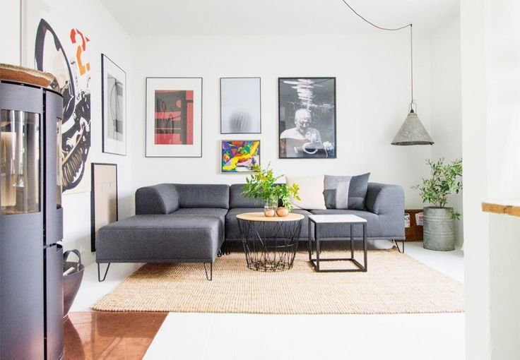 Beautiful living room with graphic illustrations and beautiful photographies that framed the room.