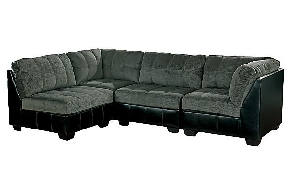 "The Hobokin - Pewter Sectional from Ashley Furniture HomeStore (AFHS.com). With the unlimited configuration options this modular collection offers, the two-toned contemporary style of the ""Hobokin-Pewter"" features a soft upholstery fabric surrounding the tufted seats and backs which is perfectly complemented by rich faux leather polyurethane all of which are beautifully adorned with jumbo accent stitching."