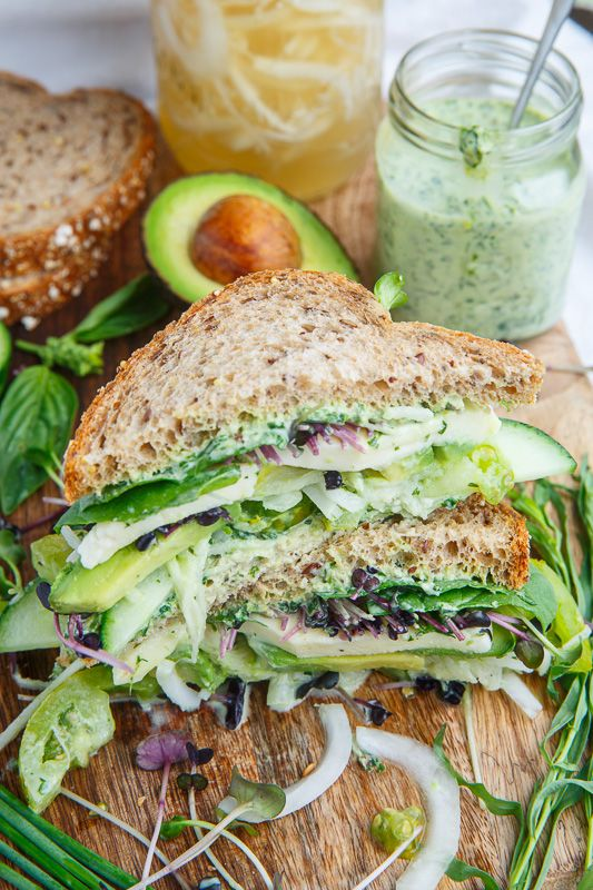 Green Goddess Sandwich - I use Stonewall Kitchen pesto mayo and swap the tomatoes and pickled radishes for cucumbers and marinated peppers. Great for lunch!
