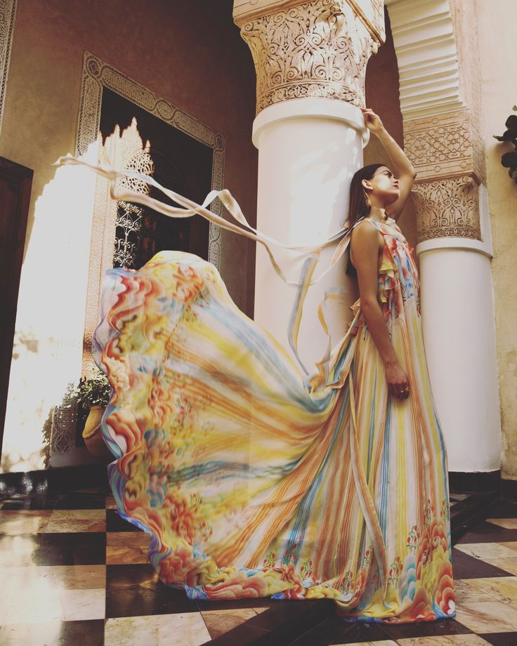A kaleidoscope of sun-bleached colours define the romantic rainbow-coloured Nymph Evening Dress.