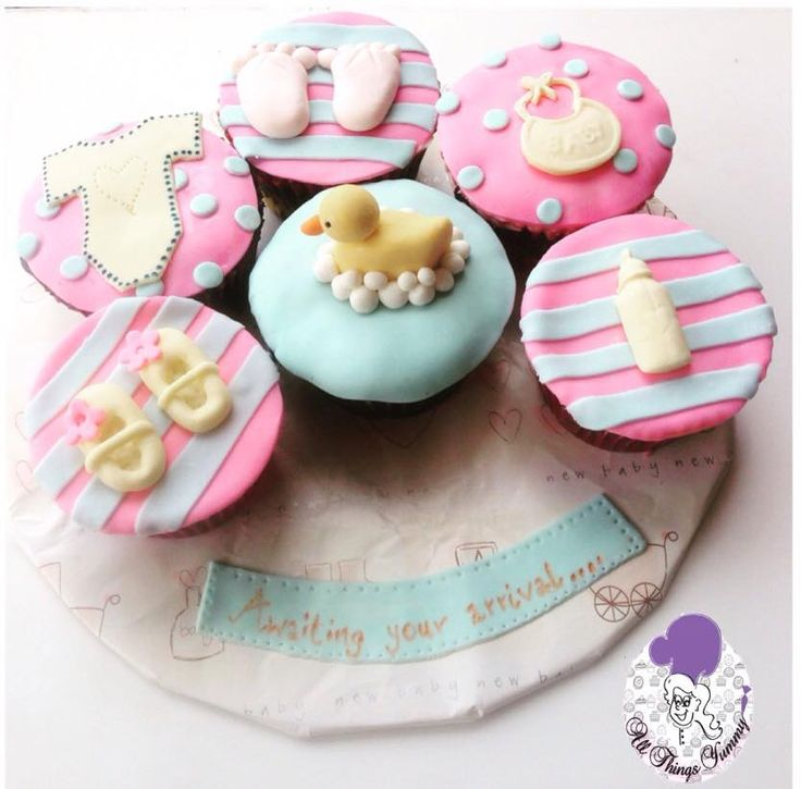 Baby Shower Cupcakes - Chocolate Flavored Baby Shower Cupcakes with Ducks, Pacifiers, Bibs, Rompers and Baby Shoes | All Things Yummy #allthingsyummy #babyshower #cupcakes #bibs #pacifiers #rompers