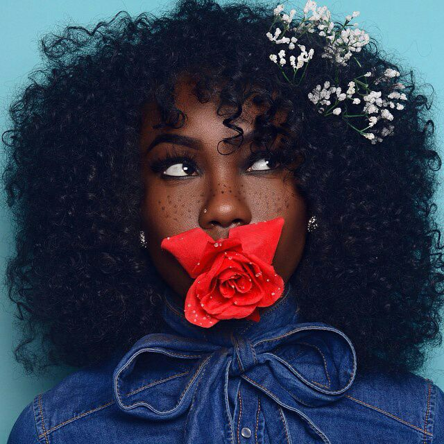 Young, gifted and black — Afro Hair with flowers