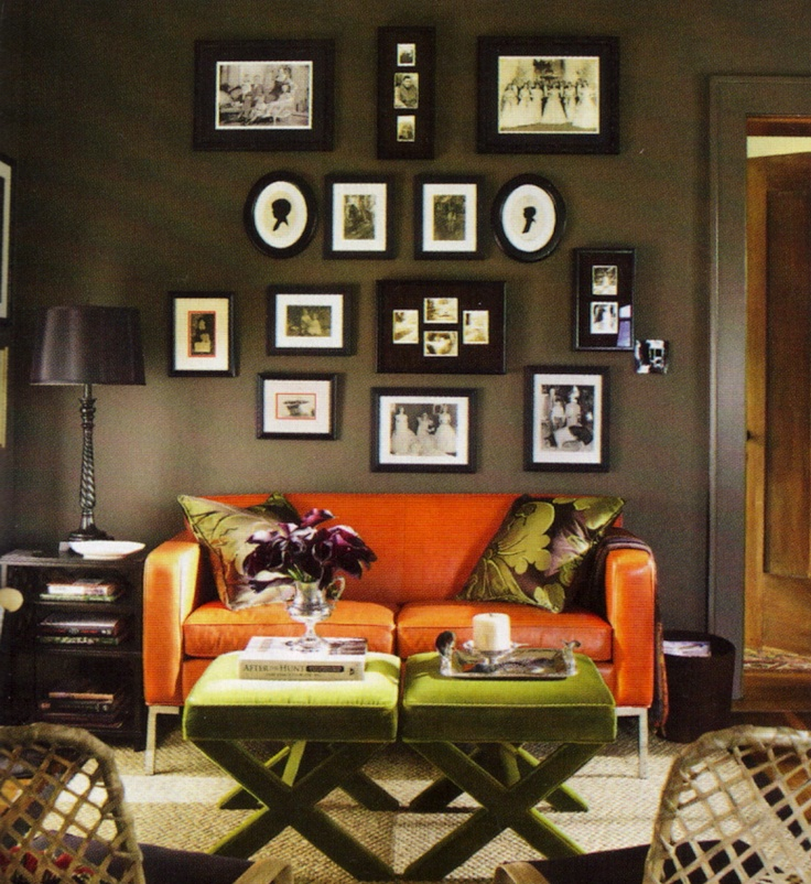 Living room w burnt orange sofa dark colored walls and