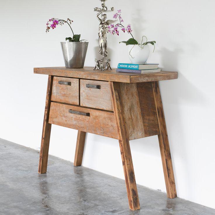 Консольный стол из тика трапецивидной формы с тремя вместительными ящиками , отделка Soul.             Материал: Дерево.              Бренд: Teak House.              Стили: Лофт, Скандинавский и минимализм.              Цвета: Коричневый.