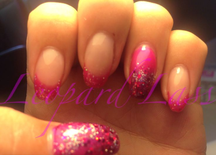 Hot pink french acrylic nails with mixed glitter
