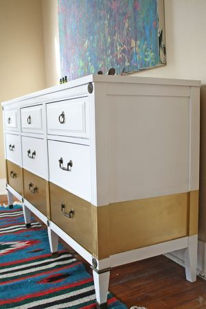 DIY painted dresser LOVE the gold stripe.  Would like it better with a color rather than white.  And add some unique drawer pulls.