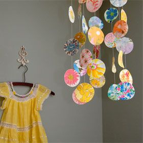 Mobile with vintage wall paper // I love the idea of hanging special dresses on the wall.