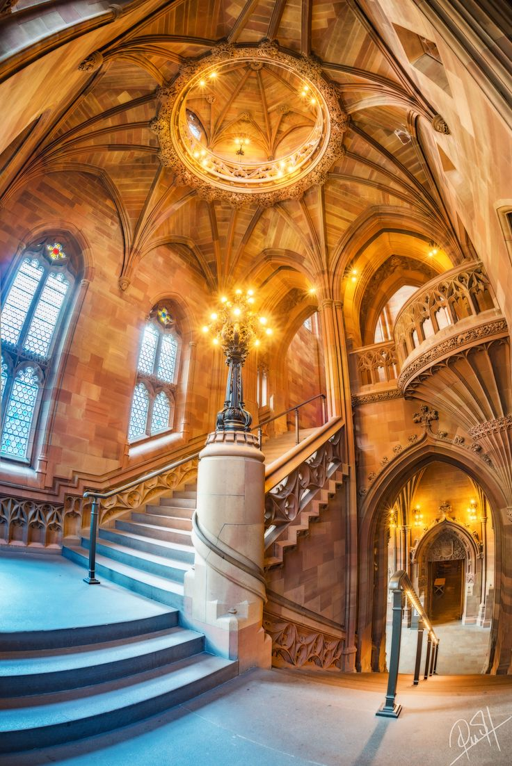staircase in Victorian Gothic John Rylands Library, part of University of Manchester in England, opened 1900, UK