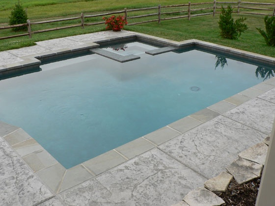 Concrete Pool Ideas stamped concrete decking by padinka via flickr This Decorative Concrete Pool Deck Stayed With Concretes Natural Coloring And Also Included Subtle Texturing