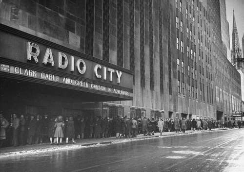 "Long lines at Radio City Music Hall for ""Adventure"" with Clark Gable & Greer Garson  Tagline: ""Gable's Back and Garson's Got Him""."