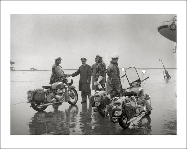 General 'Jimmy' Doolittle thanks his Ariel motorcycle escorts during a visit to rainy Melbourne in 1956. https://www.flickr.com/photos/69559277@N04/8994354511/in/faves-40906112@N07/