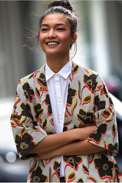 Kimono-style jackets tend to have more of a boho feel as of late, but here's a simple way to make it feel more polished. Just wear it with a classic white button-down shirt with the collar buttoned and complete the look with a pencil skirt or black trousers.