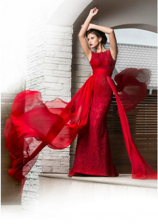 Red is the color of passion, elegance and seduction. Wear Isis, a stunning backless red lace mermaid evening dress and you are ready to play the lead part in your very own love novel. The red veil detail around the waist is detachable.