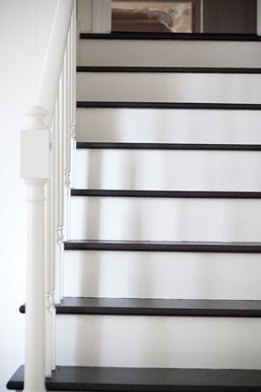 black and white stairs with white railing  {Ripped out the fugly carpet and tackling this project}