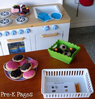 Dramatic play bakery kit from Prek Pages. I like the idea of a bakery play area instead of just a generic play kitchen space.