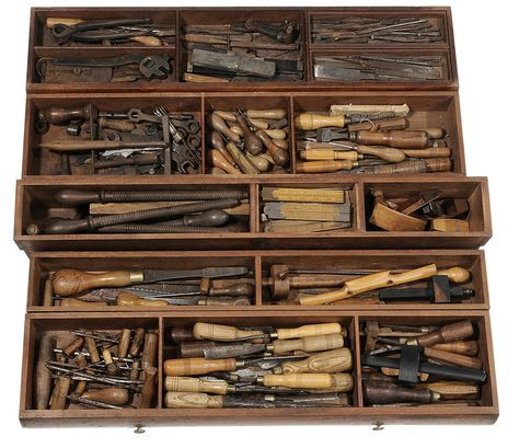 """Lot 308 from Brunk Auctions' July 20th Sale - Fine Mahogany Carpenter's Chestwith Extensive Tool Collection -  American or British, 19th cen., finely crafted dovetailed chest fitted with five compartmentalized removable sliding trays over three additional lower compartments, entire chest filled with an extensive collection of vintage woodworking and other tools, many with stamped signature for """"L. Cooper"""" (presumably the original owner of the chest), 21 x 39 x 22 in - Estimate $1,000 to…"""