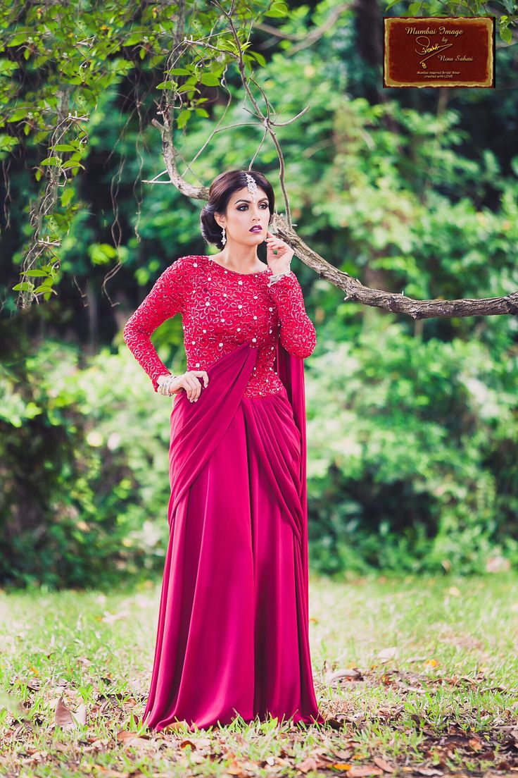 Topping up our current obsession list ! Floral, Feminine and Figure Flattering beauties ~ our Saree like evening dress in Maroon               Mumbai Image By Nora Sahari