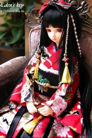 Beautiful Japanese doll dressed in kimono