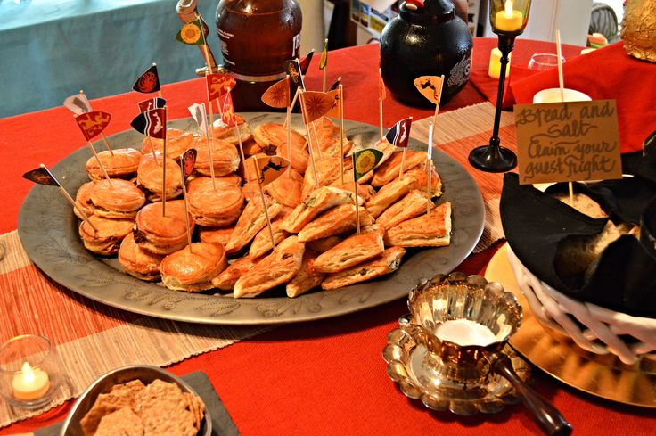 Meat pies with Game fo Thrones house sigil banners - A Game of Thrones Party, Part 2- The Food & Drink   Noble Hostess