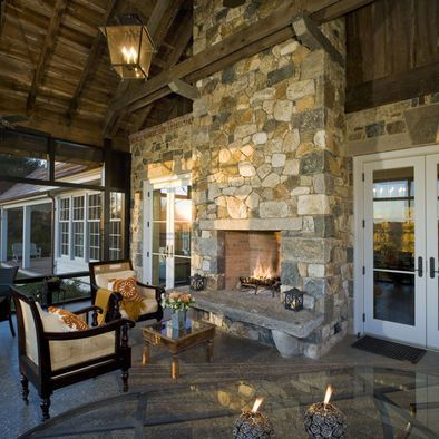 Traditional Double Sided Fireplace enjoyed from living room and patio