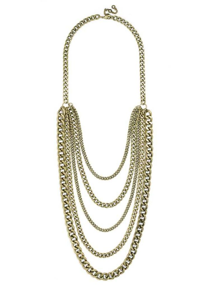 A bevy of curb chains in varying sizes lend messy, unkempt layers to a neckline. Bauble Bar