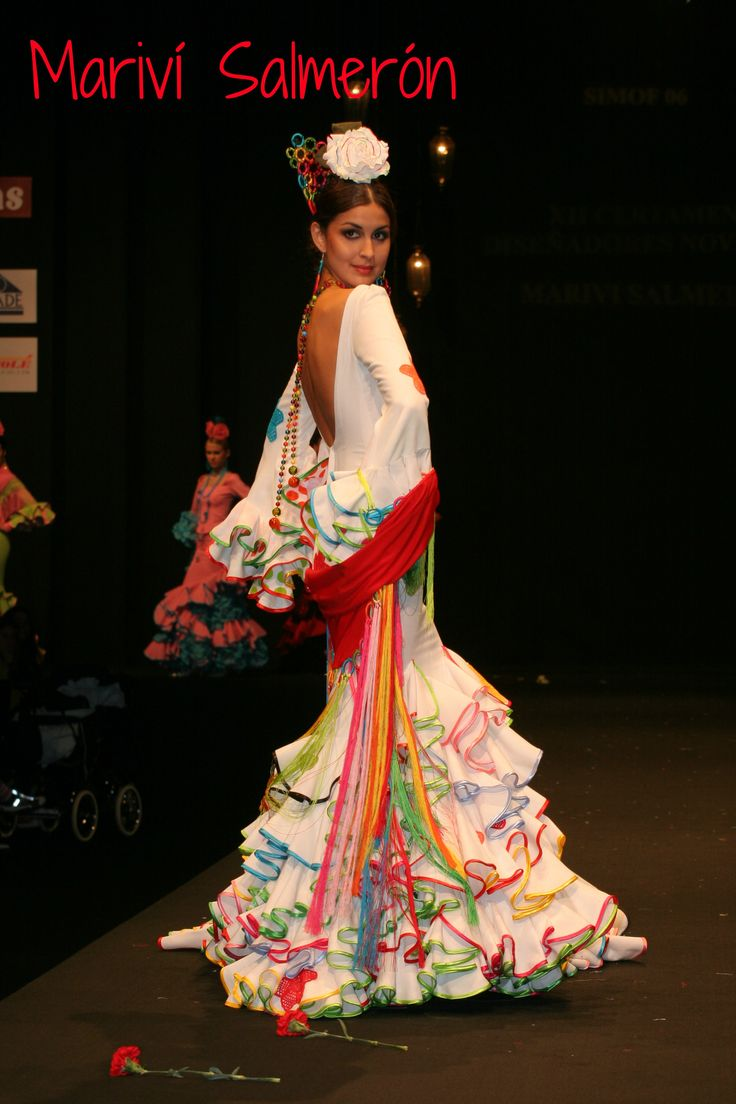 White with multi-coloured bias edging on the frills. This would have been my perfect Flamenco dress when I was little.