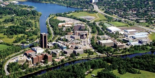 Carleton University is bounded by the Rideau River on one side and the Rideau Canal on the other side.