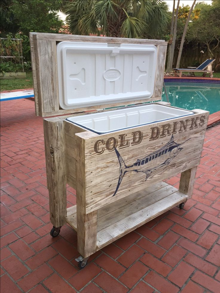Patio cooler, handmade with old fence boards and pallets. then stenciled with a Shadowed Serif font. DIY Outdoor wood framed cooler