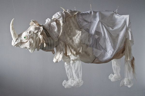 """Dürer's Rhinoceros, 2011, 84"""" x 32"""" x 60"""", materials: resin, silicone, recycled textiles, flax., technique: casting, textile deconstruction, machine and hand sewing  by:  Emily Jan of Oakland, CA"""