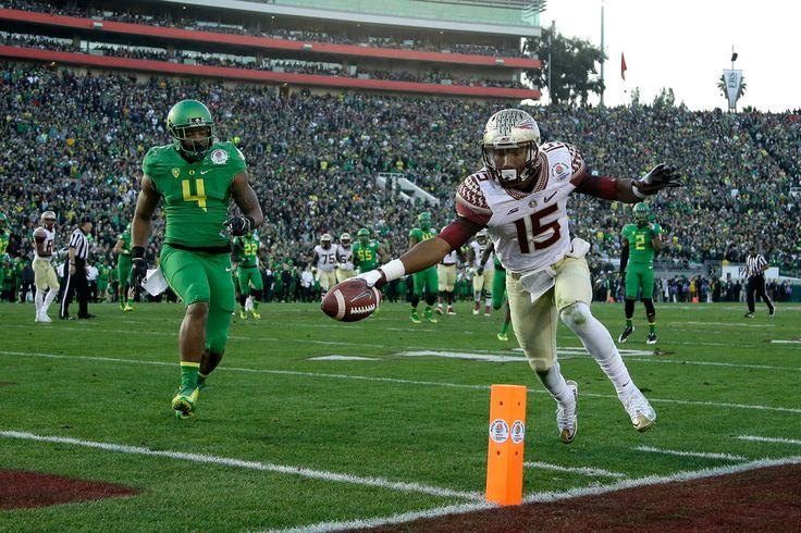 Wide receiver Travis Rudolph #15 of the Florida State Seminoles scores on a 18-yard pass from quarterback Jameis Winston #5 in the third quarter of the College Football Playoff Semifinal against the Oregon Ducks at the Rose Bowl Game presented by Northwestern Mutual at the Rose Bowl on January 1, 2015 in Pasadena, California. (Dec. 31, 2014 - Source: Jeff Gross/Getty Images North America)