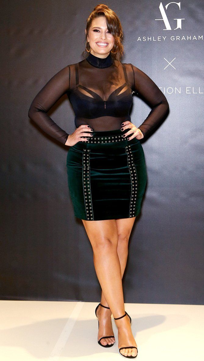 2ca1c62e7d4 Ashley Graham in a black sheer top and velvet mini skirt  curvyfashion