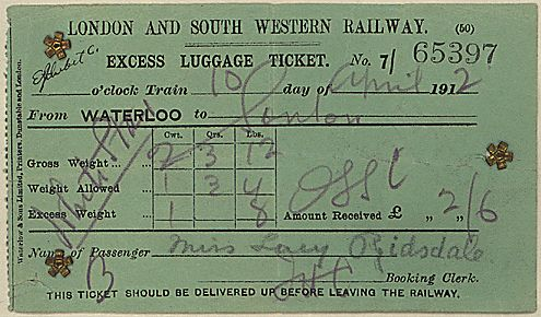 """The caption reads: """"This excess luggage ticket belonged to Lucy Ridsdale, a passenger aboard the Titanic. Traveling in 2nd Class, Lucy Ridsdale boarded the Titanic with all of her possessions intending to join her 3 sisters in the Midwest.  She would survive the disaster aboard lifeboat 13.  Among the items she lost—a Gold Watch."""""""