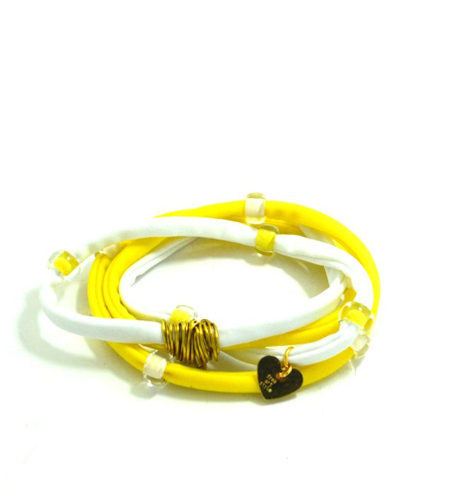 Douple lycra cord in yellow and pink embellished with unique glass beads and handmade gold wire detail. Length approx. 40 cm. Each. Two (2) turns each round the wrist. Adjustable bracelet, fits to all wrist sizes. Comes in a gift box. now @ fwww.freeartstyle.com