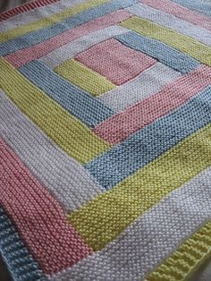 Four Colour Log Cabin Baby Blanket by Haley Waxberg. Free pattern.