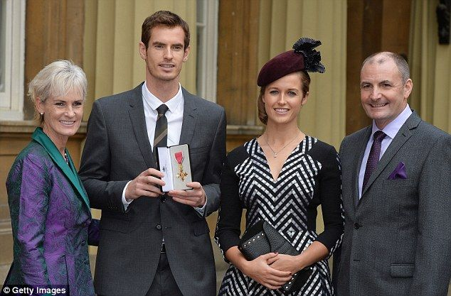 Showing it off: Andy Murray with his OBE alongside his mum Judy, dad William, girlfriend Kim... and dog