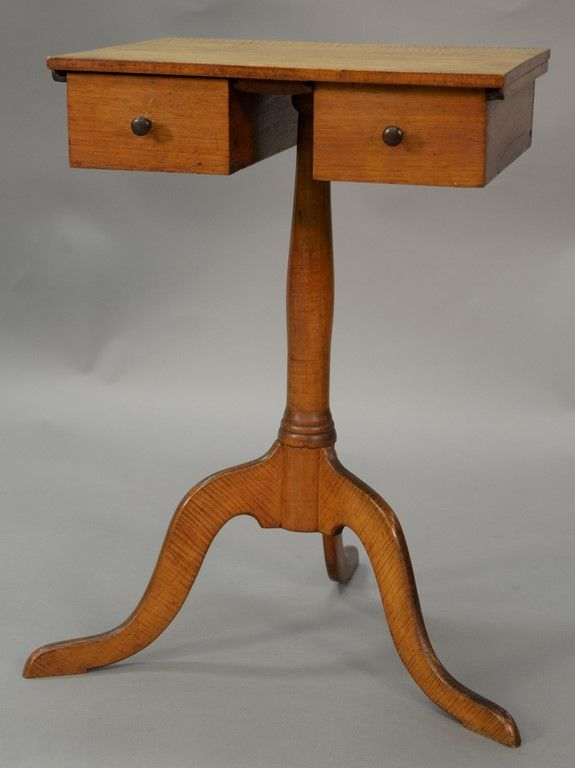 Shaker tiger maple candlestand having square top over two drawers set on plain turned shaft set on tripod base, circa 1800 ~ Realized Price $9,600.00  #nadeausauction