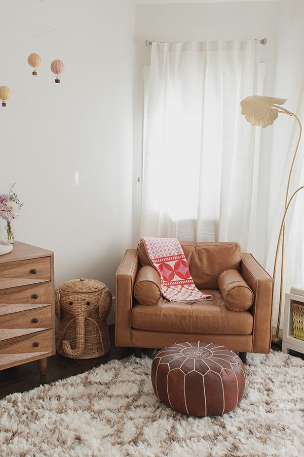 An unexpected, but cosy, nursery made unique by our cognac leather armchair. Its wide seat provides ample room to cuddle with a newborn.