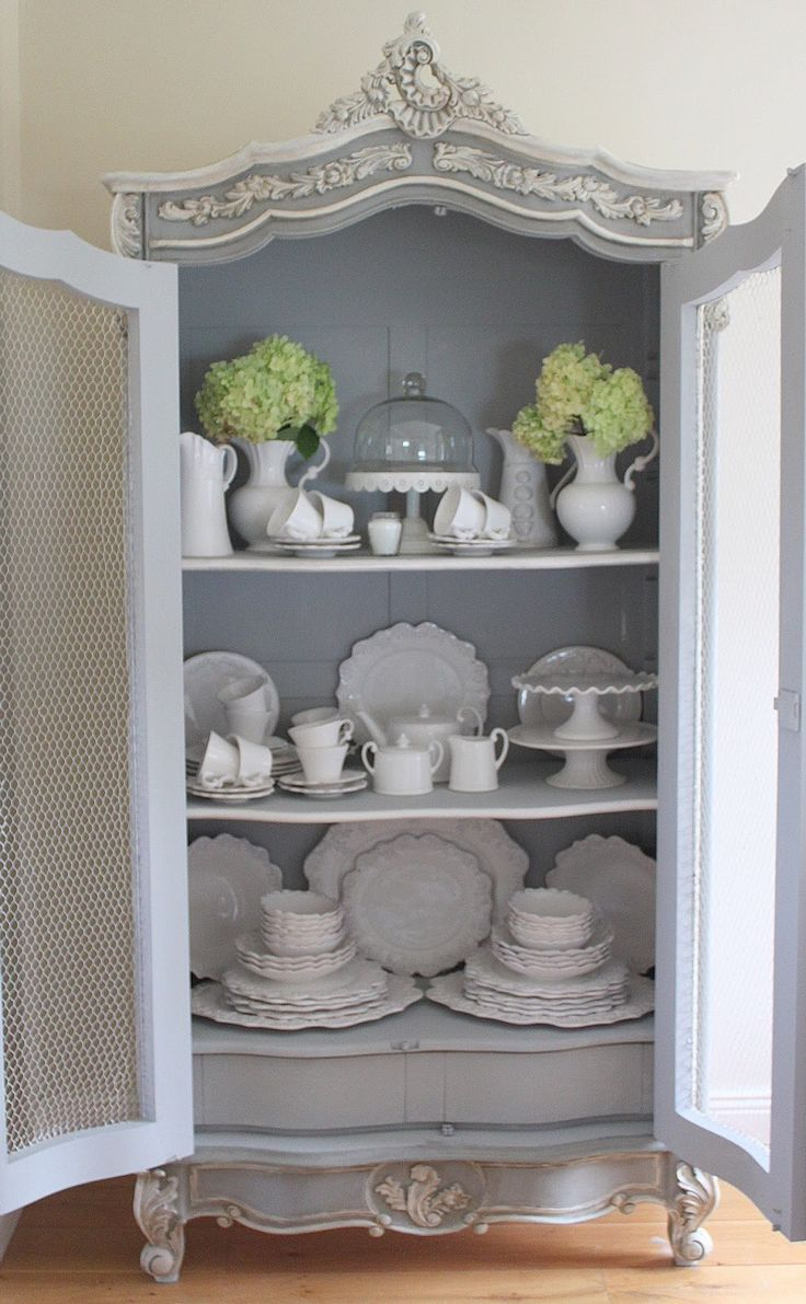 Annie Sloan Chalk Paint.. Mix of Paris Gray & Louis Blue w/Old White on raised areas.. Both clear & dark wax