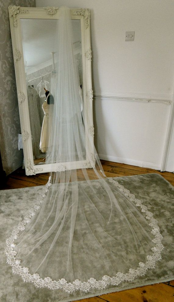Soft flowing tulle long wedding veil with a choice of two fabrics.  Fabric options for this veil soft tulle (pictured) or a silk tulle.  Veil length