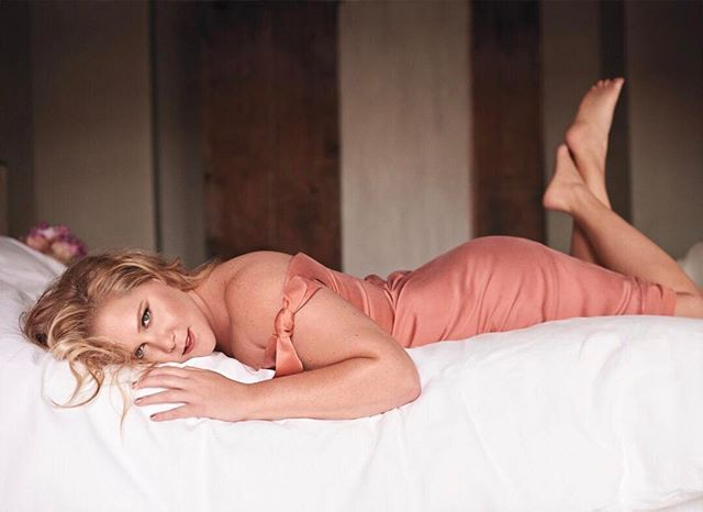 """Does May cover star @AmySchumer always lounge around in silky @zimmermann dresses? Not so much. """"In terms of decompressing I also want to get into pajamas as often as possible usually sweatpants and rarely a bra at any point to watch TV. Then I think a beautiful thing is having wine. And some pot"""" she tells @JessSeinfeld in her May cover story.  